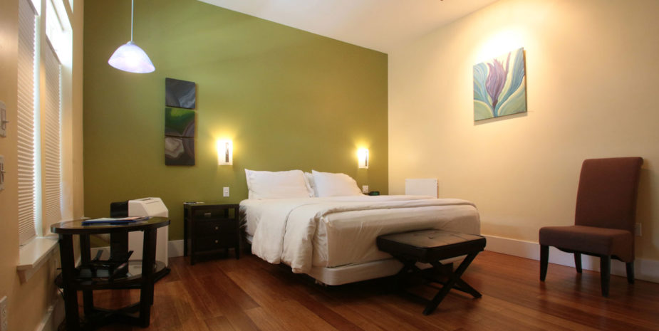 All rooms have a California King bed as shown, except Room 101 which has a queen size bed.